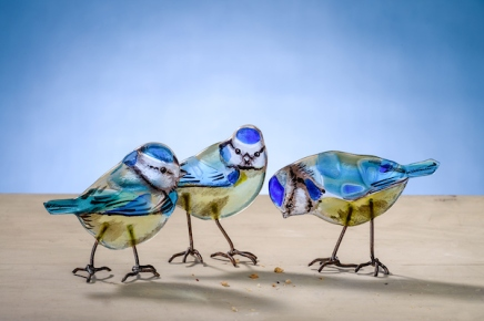 Handmade glass birds, Blue Tits by artist Emma Butler-Cole Aiken, who is based in the Scottish Borders. Emma is an architectural glass artist creating contemporary work using traditional materials. She has created around 75 commissioned works throught the UK. Emma is captivated by the colours, textures and exuberant beauty of glass. Seeking magical combinations of image and material, she strives to reach beyond the ordinary to create unique works which stand the test of time. Discerning when to allow a particular colour to shine out unhindered and when to bring control and distinction is a continuous process, the choices of possible outcomes almost overwhelming. In this creative process her faith and light emerge.